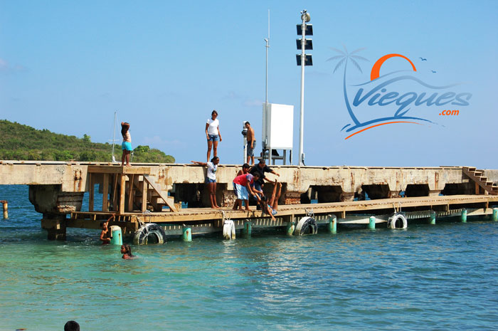 Viequenses having fun jumping off the pier. Come and Join Them !